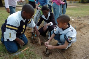 children, measuring, hole, deep, enough, planting, flowers