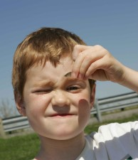 up-close, face, young boy, holds, small, fish