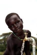 up-close, portrait, young, African, boy, fetches, water, water, source