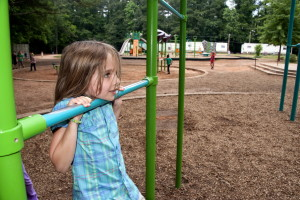 face, girl, hanging, arms, one, playground, green, blue, pull, bars