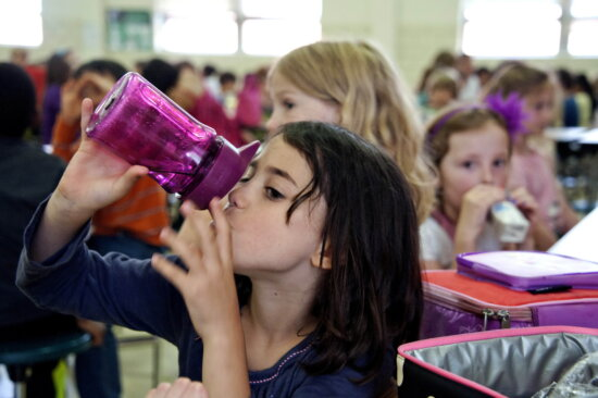 girl, photographed, taking, drink, water
