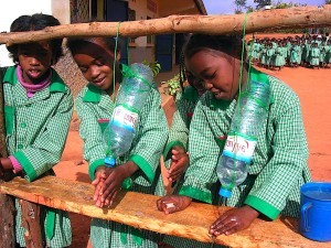 girls, madagascar, simple, hand washing, device, consists, hanging, water