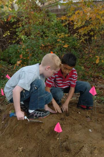 two boys, play, digging, ground
