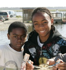 two, young, African American, boys, smile, proudly, crab