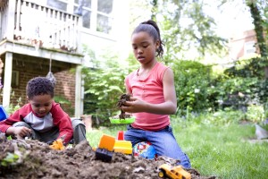 two, young, African American, children, play, outside, backyard, dirt, pile