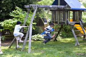 two, young children, play, wooden, swing, set