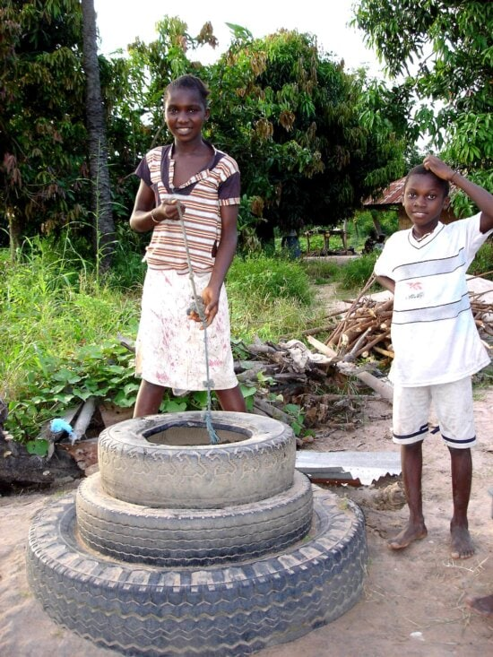 young boy, girl, Africa, collecting, water, uncovered, well