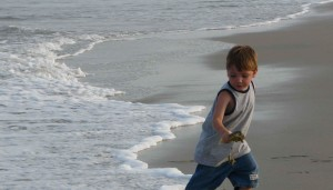 young boy, runs, surf, beach, coast