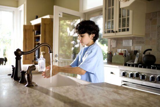 young boy, shown, process, washing, hands, kitchen, sink