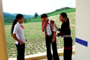 young girl, shares, joke, friends, outside, school, Vietnam