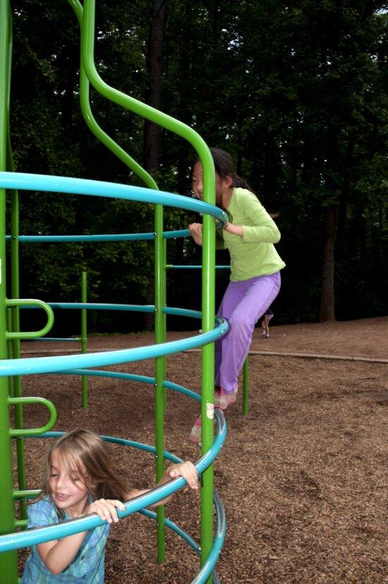 young girls, climbing, play, yard, metal bars