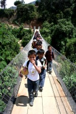 young, school kid, rural, Guatemala, hanging bridge