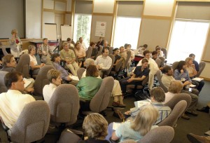 audience, classroom, listening, intently, speaker, meeting