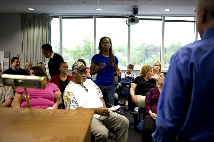 man, meeting, question, posed, participating, African American, woman