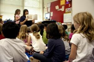 typical, classroom, scene, audience, school children, sitting, floor