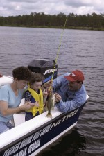 daughter, father, mother, catches, fish, boat
