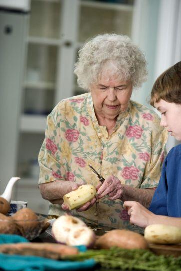 elderly, woman, teaching, grandson, peel, sweet, potatoes