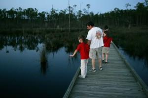 family enjoying, water, wooden, catwalk