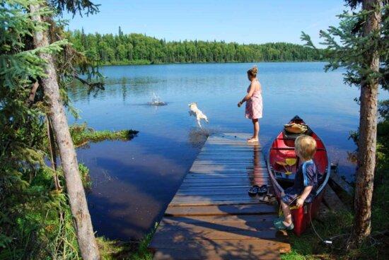 family, mom, son, dog, lake, pier, boat