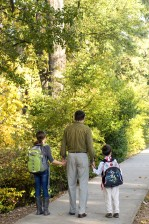 father, two, children, walking, sidewalk