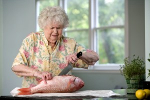 elderly, CaucAsian, woman, process, food, preparation, filleting, fresh, fish