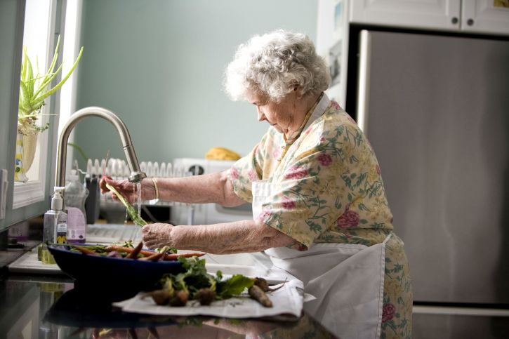 elderly, woman, kitchen, cleaning, carrots, radishes