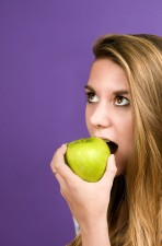 face, young woman eating, green apple