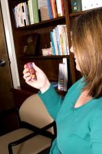 female, diabetic, patient, reading, label, bottle, glucose, tablets
