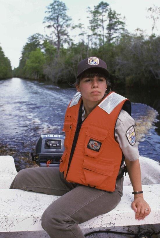 female, employee, uniform, drives, small, motor, boat