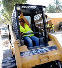 female, heavy, machinery, operator, talks, colleague, seat, excavator