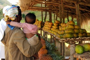 female, holding, child, arms, farmer, market, Farafangana, Madagascar