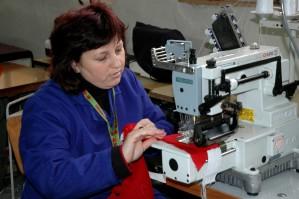 female, worker, demonstrates, stitch, sewing machine