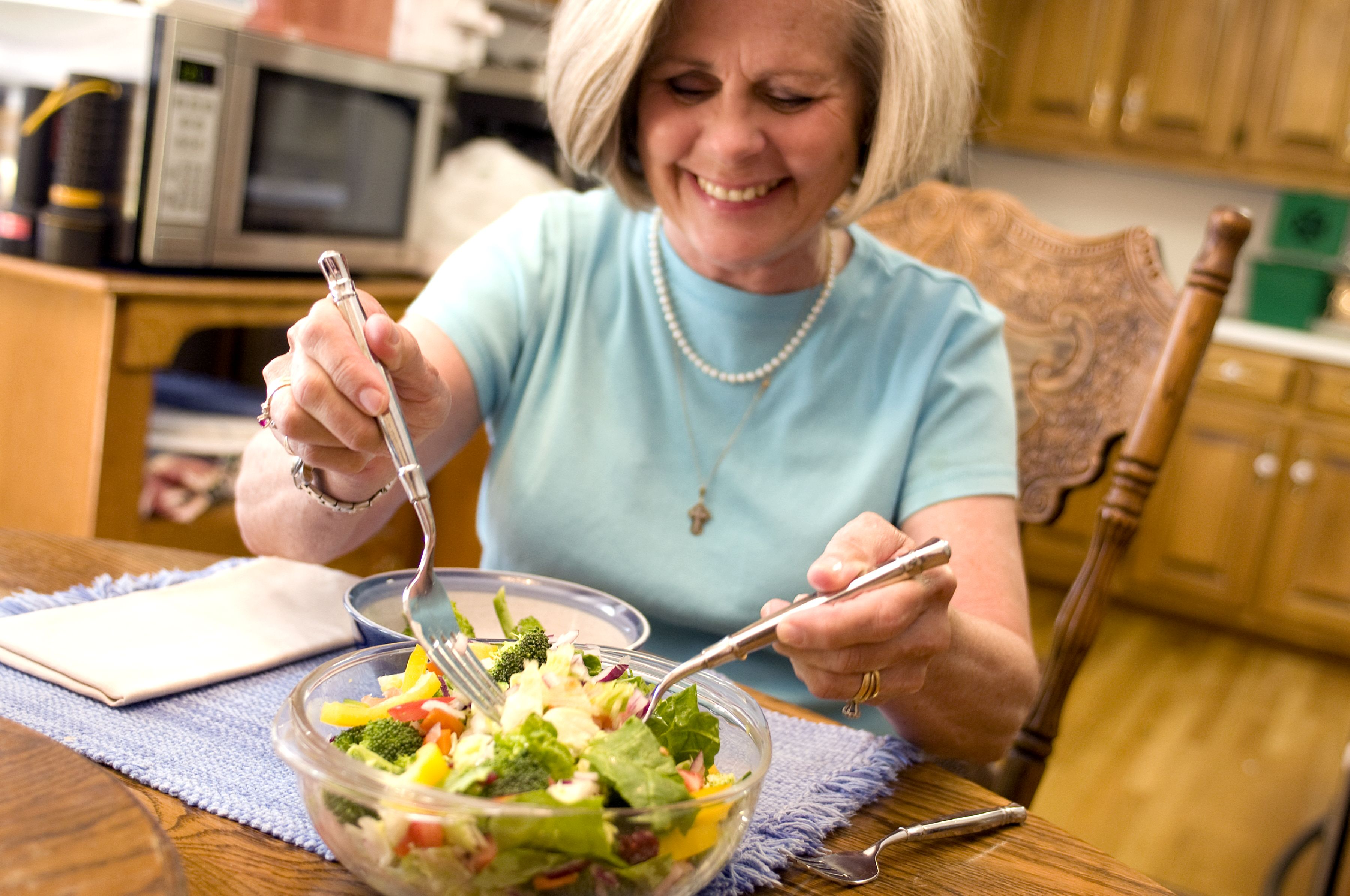 Small Eat In Kitchen Table Free Picture Happy Woman Eating Vegetable Salad