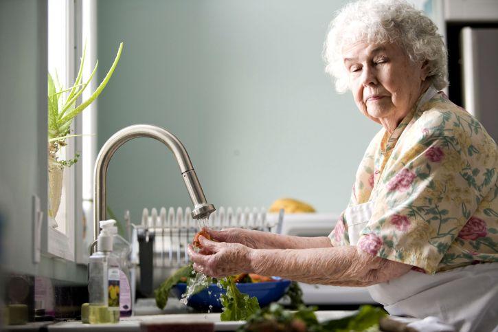 old woman, kitchen, washing, carrots, radishes