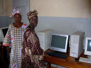 two, women, community, radio, station, stands, computers, access, internet
