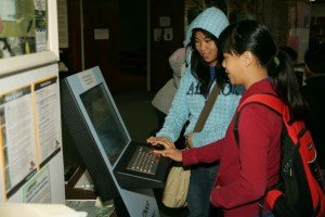 two, young, women, embracing, technology, enjoy, computer