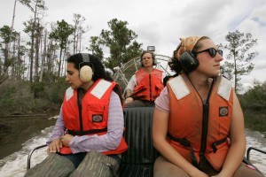 two, young, women, wearing, ear, protection, driven, volunteer, destination, air, boat