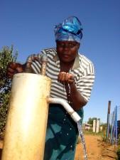 woman, drinking, clean, water, water pump, rural, village, Johannesburg, Africa