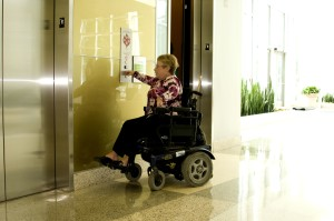 woman, wheelchair, pressing, easily, reachable, button