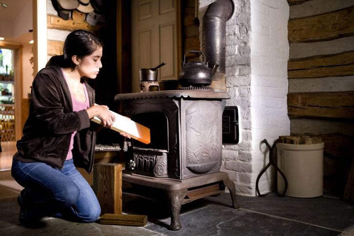 Free Picture Woman Safely Operate Wood Burning Stove