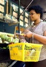 Afro woman, shopping market, vegetables