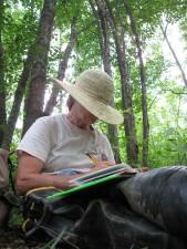 kvinne, med lue, skriver, sitter