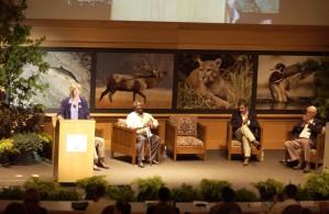 women, speaking, podium, summit