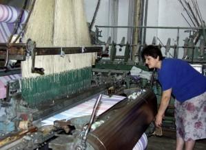 worker, Florjan, factory, tends, massive, loom, towels