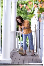 young, brunette, woman enjoying, beautiful, day, cleaning, balcony