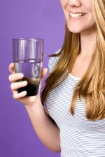 young woman, holding, glass, water, hand