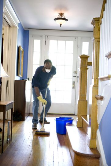 African American, man, personal, protective, equipment, cleaning, home, damp, mop
