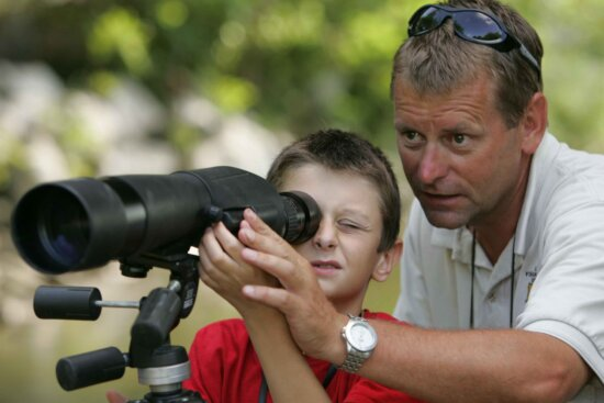 father, helps, son, focus, spotting, scope, closer, look