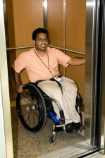 man, wheelchair, boarded, elevator, accessible, building