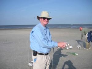 man, beach, holding, bird